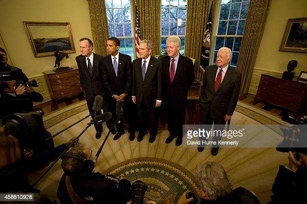 41st President George HW Bush stands next to Barack Obama who will be the 44th President as he stands next to the 43rd President George W Bush 40th...
