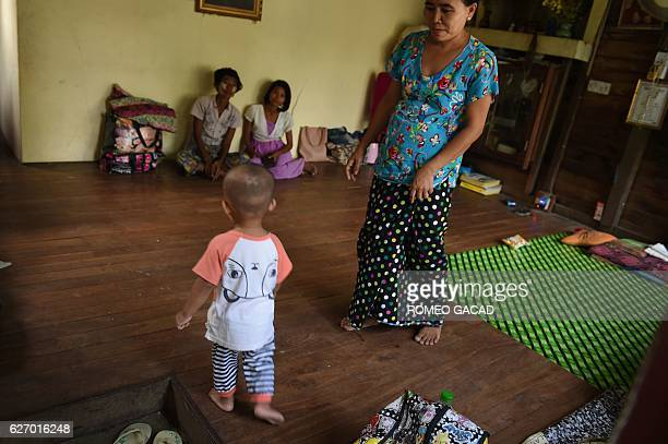 A 41year old Myanmar mother living with HIV virus looks after her son while they are both housed at the National League for Democracy HIV/AIDS Center...