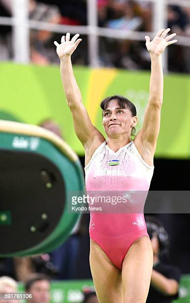 41yearold Uzbekistan gymnast Oksana Chusovitina acknowledges spectators after performing the Chusovitina technique named after her in the women's...