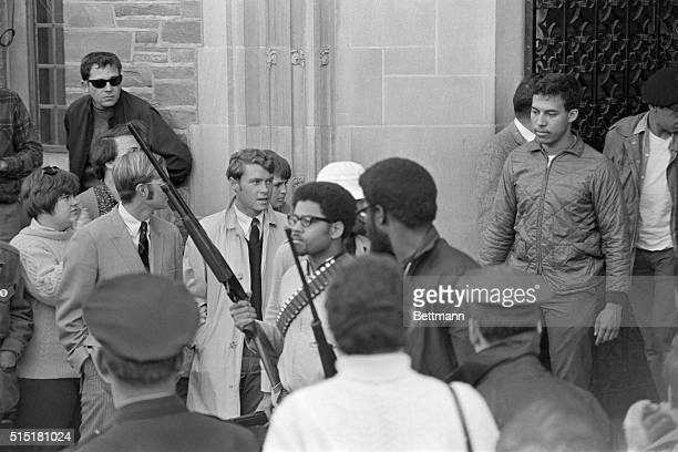 Ithaca, NY- Carrying guns, Edward L. Whitfield , chairman of the Afro-American Society at Cornell University, and Eric Evans , another leader of that...