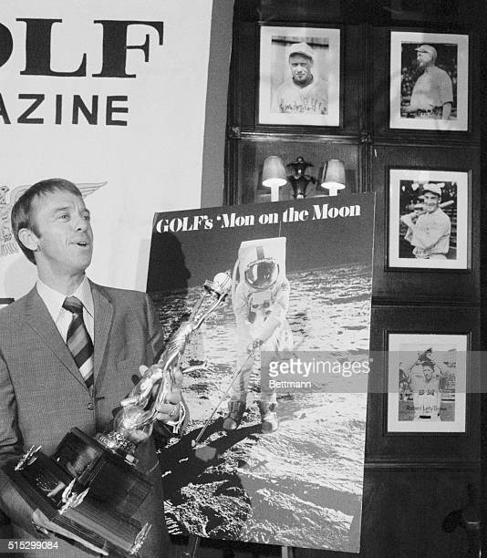 4/20/1971New York NYAstronaut Alan B Shepard Jr examines the trophy which was presented to him for his golfing exploits during the February Apollo 14...
