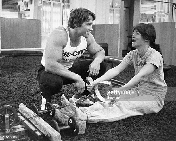 4/20/1976New York NY Actress Sally Field being trained by bodybuilder Arnold Schwarzenegger on the rowing machine
