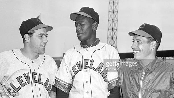 St. Louis, MO: Lou Boudreau , manager-shortstop of the Cleveland Indians, stands with two of his ailing aces in St. Louis. In the center is pitcher...