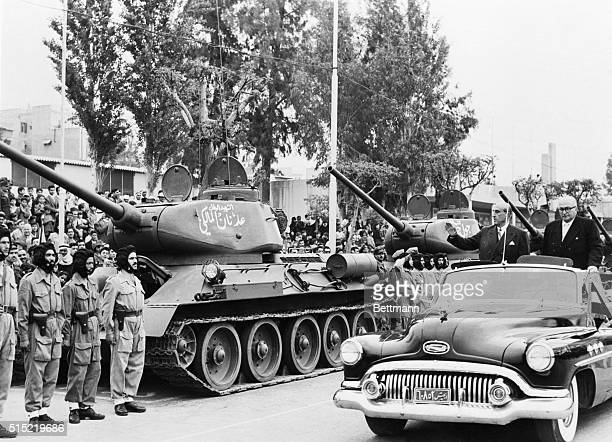 4/21/1957Damascus Syria Syria's President Shurky El Kuwatly and Defense Minister Khaled El Azem review a detachment of tank troops during military...