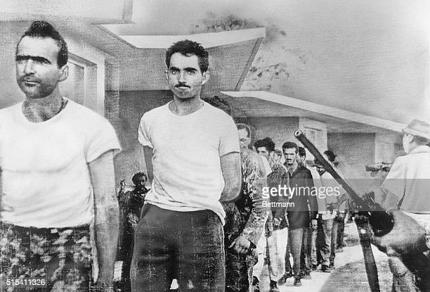 4/21/1961Havana Cuba Watched by armed guards grimfaced invaders are marched off to prison from temporary quarters at Giron Beach Las Villas province...
