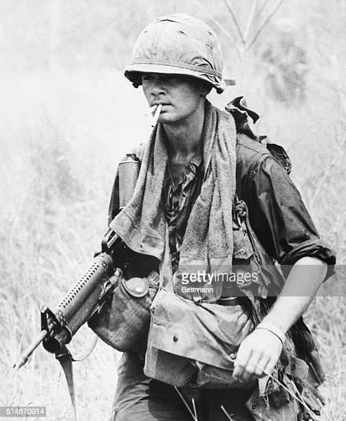 4/2/1967Quan Loi South Viet Nam With a lot on his mind and two cigarettes in his mouth A First infantry GI trudges along in search of the enemy...
