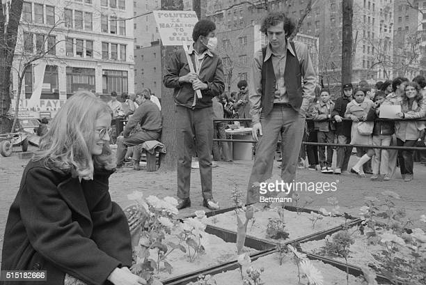 4/22/1970New York NY Earth day is in full swing in Manhattan's Union Square Park These two earthlings 'do their thing' as they pause to inspect a...