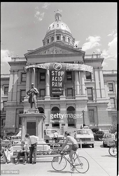 Denver, CO- A banner hung by members of the environmental groups Greenpeace and Earth First! blows in the breeze on the Colorado State capitol...