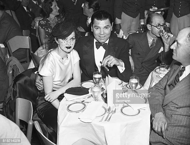New York, NY- Jack Dempsey, former heavyweight champion, and Mrs. Dempsey, the former Hannah Williams, pictured as they attended the opening of...