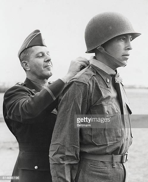 2nd Lt Ernest Childers 26yearold American Indian from Tulsa OK receives the Congressional Medal of Honor from Lt Gen Jacob L Devers Deputy Supreme...