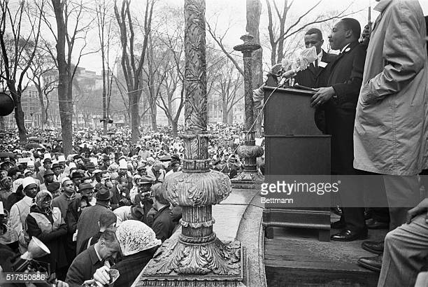 Boston, MA: Dr. Martin Luther King, Jr., r, addresses a large rally at the Boston Common, 4/23, after completing a protest march from Roxbury. The...