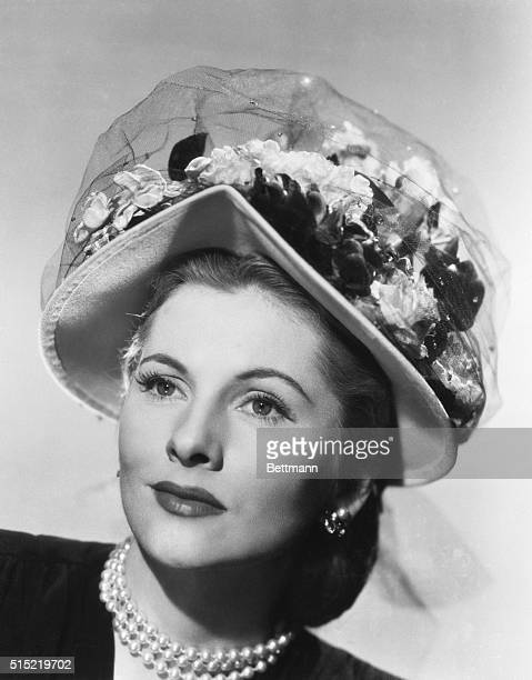 4/24/1948Hollywood CA A pastel felt bonnet topped with posies and jeweldotted manline makes a lovely hat for actress Joan Fontaine She will soon be...