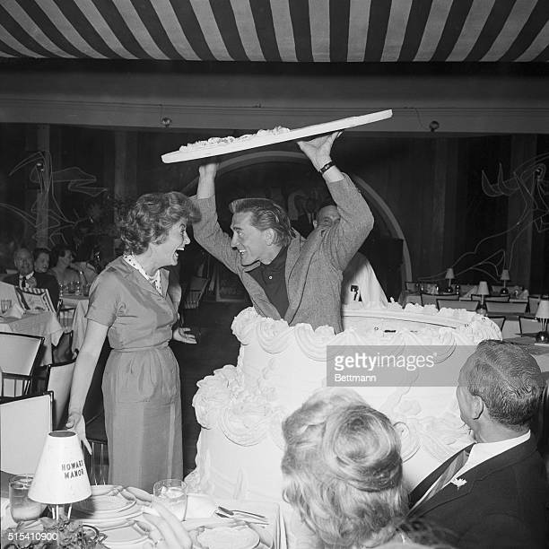 4/24/1959Palm Springs California Shrieking with delight Anne Douglas does a doubletake as her actor husband Kirk Douglas pops up out of a giant...
