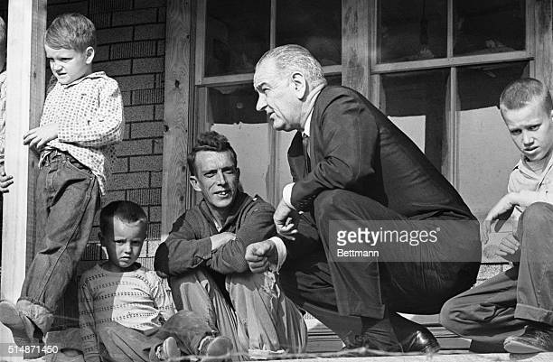 4/24/1964Imez Kentucky President Lyndon Johnson listens to Tom Fletcher describe some of the problems of the town Fletcher is the father of eight...