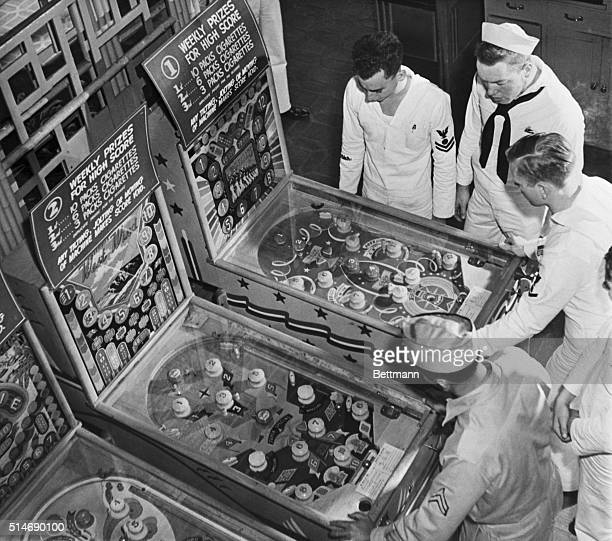 4/2/42Honolulu Hawaii This is not New Yorkpinball machines banned in the big city amuse sailors at the Royal Hawaiian Hotel on Waikiki Beach in...