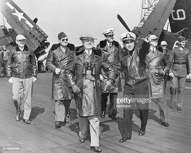 President Truman is shown on the flight deck of the giant aircraft carrier USS Franklin D Roosevelt as he watched the first postwar maneuvers off the...