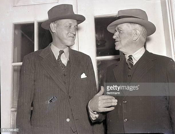 Washington, DC- WPA administrator, Harry Hopkins and Secretary of the Interior, Harold Ickes, are shown leaving the White House after conferring with...