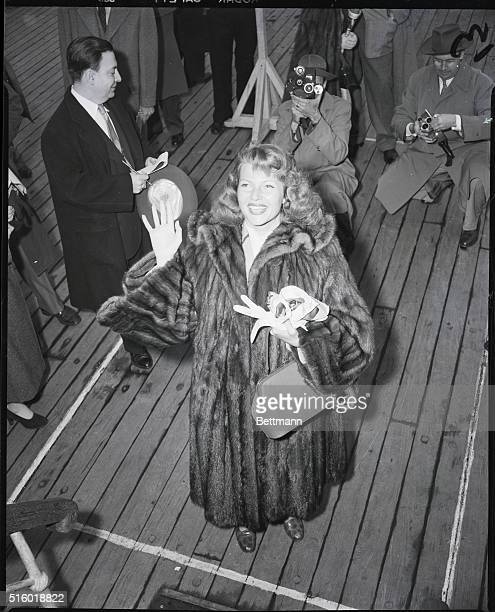 After a two and a half years' absence from the US redhaired Rita Hayworth arrives in New York April 2 aboard the French Liner Degrasse garbed in a...