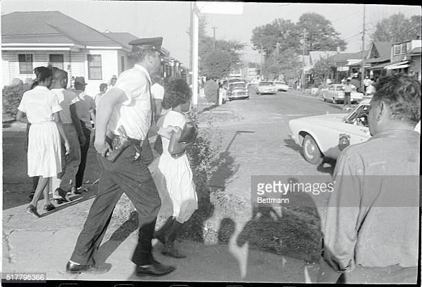 Greenwood MississippiORIGINAL CAPTION READS A Greenwood policeman takes a Negro girl to an awaiting patrol car here 4/2 afternoon after she and about...