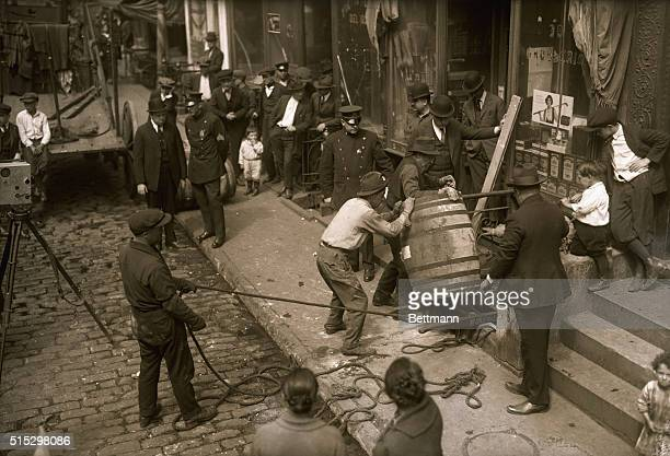 4/27/1921New York NY Seizure of wine on a court warrant at 38 Cherry Street Shows officials taking barrels from the cellar