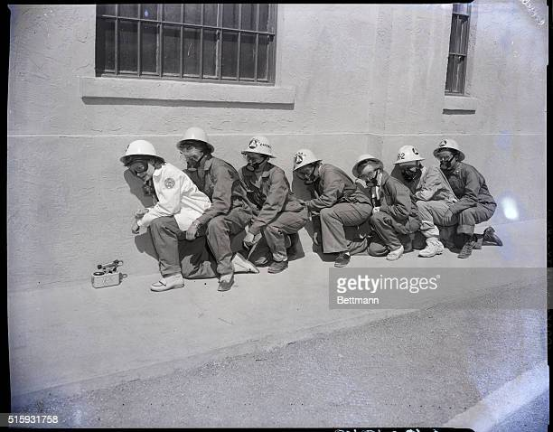 4/27/1955Yucca Flat NV Women Civil Defense workers pose as they would have been in their tranch only 3500 yards away from the monster Atomic...