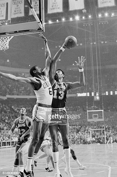 Boston, Massachusetts: In the Lakers-Celtics match, Wilt Chamberlain , of the Los Angeles Lakers challenges Bill Russell of the Boston Celtics as he...