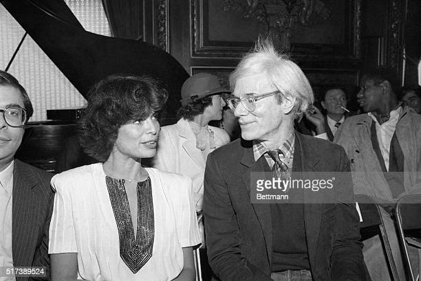 4/27/1981New York New YorkBianca Jagger exwife of Mick Jagger shares a moment with pop artist Andy Warhol at the Metropolitan Club during a fashion...