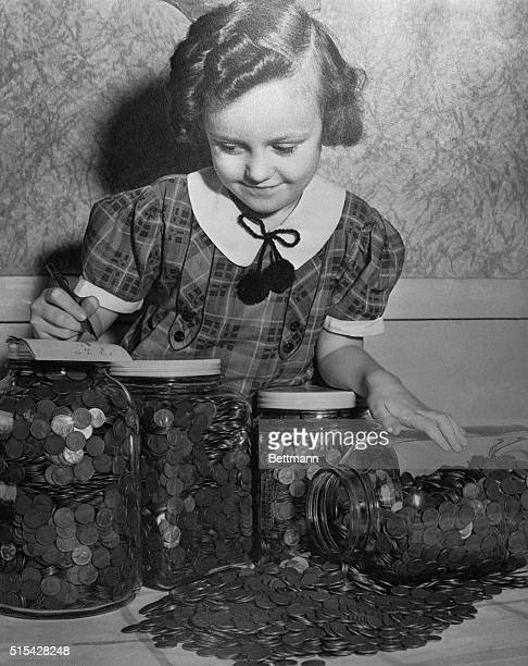 4/27/38Clevland OhioORIGINAL CAPTION READS Four gallons of pennies will form the foundation of a savings account that in due course will pay...