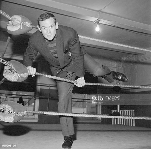 New York, NY- Climbing through the ropes, Sweden's Ingemar Johansson, the European heavyweight champion, gets the feel of the ring at the CYO...