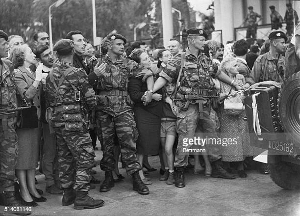 4/28/1961Algiers Algerian Paratroops in camouflage battle dress hold back the crowds of European settlers in the Forum in front of the Government...