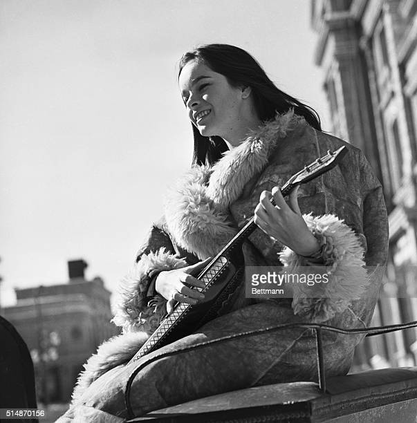 4/28/1965Madrid Spain Taking a musical break between scenes actress Geraldine Chaplin 20 year old daughter of comedian Charlie chaplin strums a...