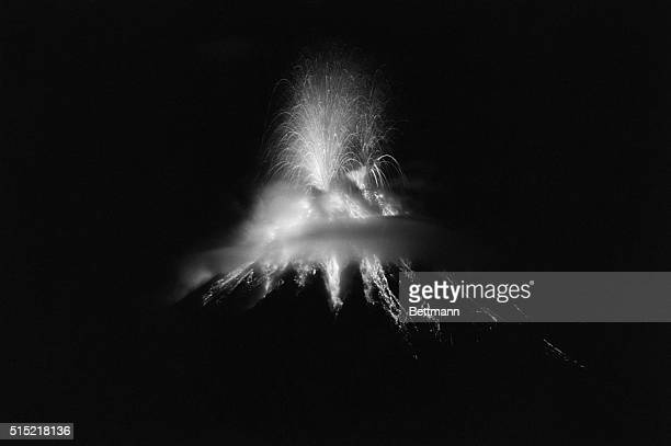 4/28/1968Manila Philippines Molten lava white hot spurts from the Mayon volcano in a wild fireworks pattern during a night eruption Two persons have...