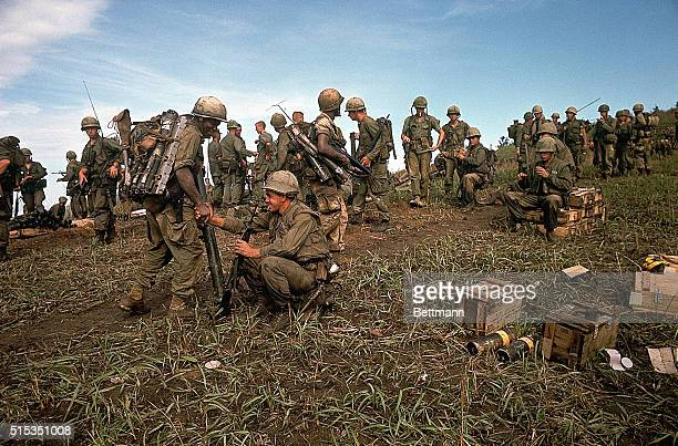 4/29/1967Hill 861 South Vietnam Picture shows US Marines at the top of Hill 861 looking over a pile of equipment left behind by slain comrades...