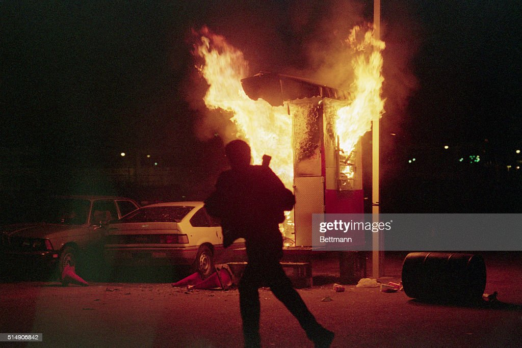 Running Man Silhouetted By Burning Shack : News Photo