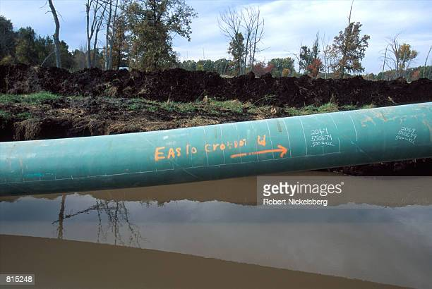 A 42inch of pipe transverses a peat bog in a wetlands area October 3 2000 in Howell Michigan 60 miles north of Detroit The pipe will eventually be...