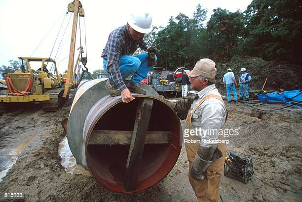A 42inch pipeline is encased in a sleeve of concrete before being submerged underwater in a wetlands area October 3 2000 near Howell Michigan 60...