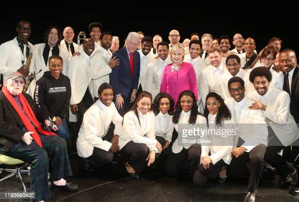 """42nd President of the United States Bill Clinton and Hillary Clinton pose backstage with the cast and company at the musical """"Ain't Too Proud: The..."""