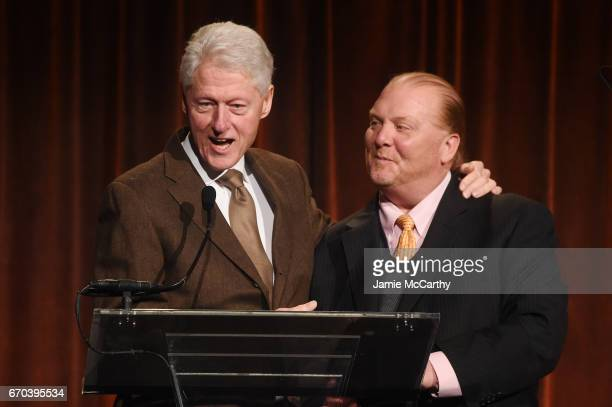 42nd US President Bill Clinton and Mario Batali speak on stage at the Food Bank for New York City CanDo Awards Dinner 2017 on April 19 2017 in New...