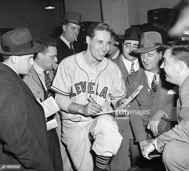 4/30/1946New York NY Bobby Feller 27yearold Cleveland Indians' righthander signs autographs for reporters in the dressing room after his 10 nohit...