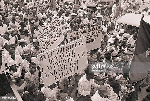 4/30/1963PortauPrince Haiti May Day celebrations begin early with orderly rather cheerful crowds bearing signs such as the one in the foreground...