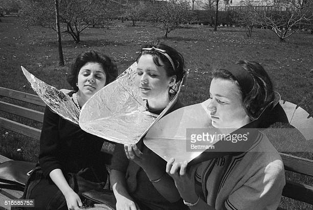 4/30/1965New York NY Josephine Virgilio Brooklyn and Joan Sharot and Harriette Thaxter of Manhattan Use home made reflectors for some extra sun as...