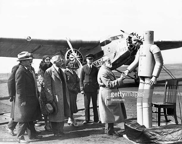 'Vocalite' the robot man wishing Charles Dickinson bon voyage just before the latter took off in the first plane of the new 31hour service between...