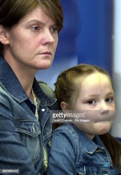 43yearold Ann Tiffney holding sixyearold Hannah daughter of missing Edinburgh woman Louise Tiffney during a press conference in Edinburgh police...