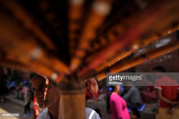 43yrs old MOHAMAAD YUNUSHA a migrated Indian worker awaiting customer to sell traditional bamboo flute at Patan Nepal on Saturday April 21 2018 He...