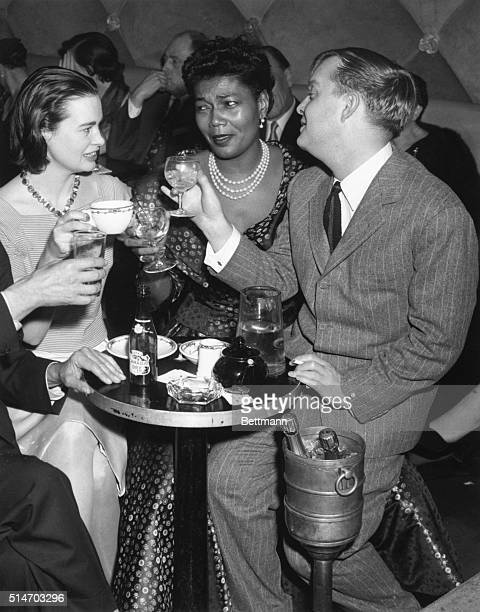 New York: Husky-voiced singer Pearl Bailey is toasted by actress-heiress Gloria Vanderbilt and author Truman Capote at the Blue Angel on the occasion...