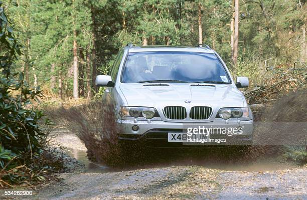 X5 44i in muddy puddle 2000