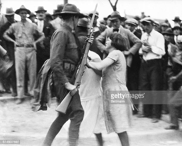 4/5/1929Gastonia NC Photo shows a group of girl textile strikers attempting to disarm a National Guard trooper who was ordered to the Loray Mills...