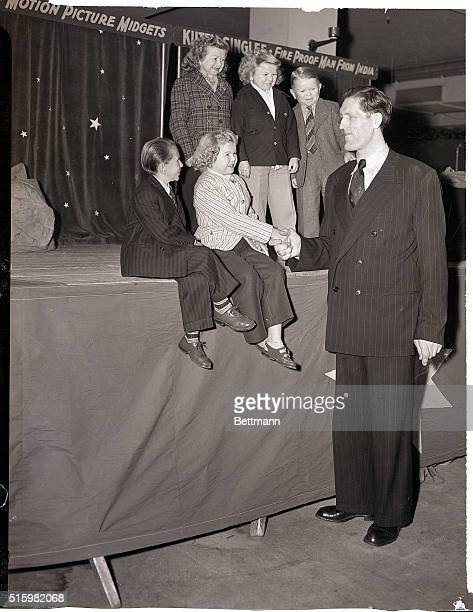 4/5/1948New York NY Johann Petursson eightfeeteightinch giant from Iceland gets acquainted with the Doll Family midgets with the Ringling Brothers...