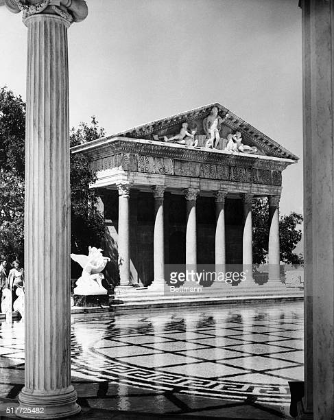 4/5/1958San Simeon CA An authentic Grecian Temple ornaments the side of William Randolph Hearst's outdoor swimming pool on the grounds of San Simeon...