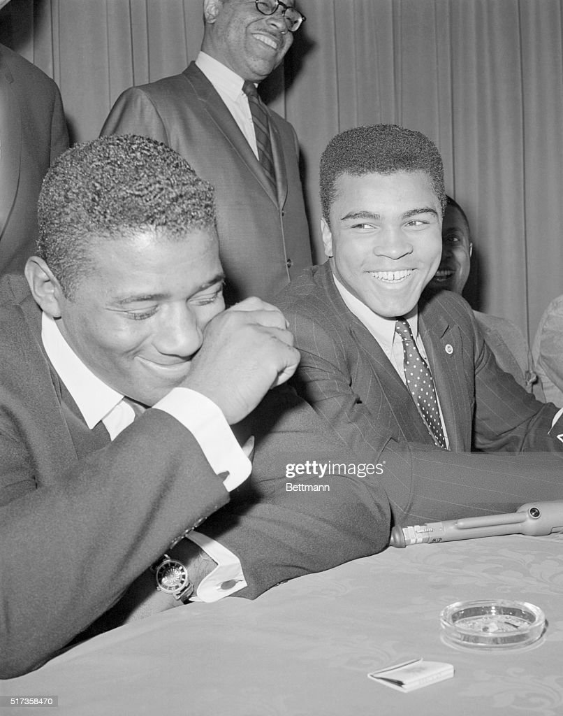 New York, NY- Floyd Patterson (L) and Cassius Clay make a handsome picture as the two sluggers sign to meet for the world heavyweight championship that Clay holds and that Patterson once held. The bout is scheduled for April 25th in Las Vegas. The last time the two men met in the ring, also in Las Vegas, on November 22, 1965, the fight was stopped in the 12th round by a referee who said that Patterson had been 'outclassed.'